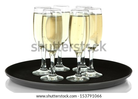 Many glasses of champagne on the tray, isolated on white - stock photo
