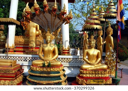 Many gold Buddhas, Vientiane, Laos (Wat Si Saket). Si Saket temple was built in 1818. It contains 6840 statues and figurines of Buddha, made in typical Lao style. - stock photo