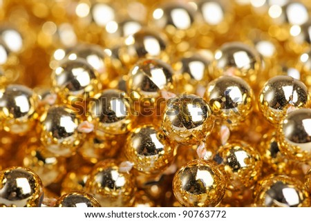 Many golden balls in horizontal composition
