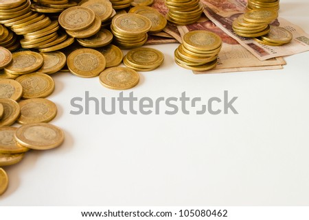 many golden coins on white background, mexican ten pesos coins - stock photo