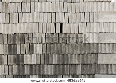 Many gray brick/concrete block texture background. a lot of overlap material prepare to built.