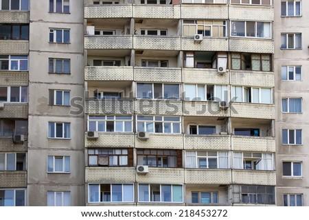many grey windows multistory home - stock photo