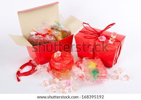 Many   handmade  soap in a red gift box on a white background