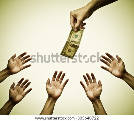many hands fighting to get money - stock photo