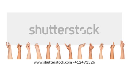 Many hands holding a blank poster for advertising on an isolated white background - stock photo