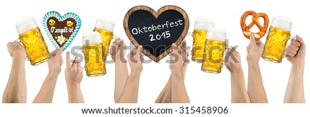 many hands holding german oktoberfest beer heart shaped gingerbread and blackboard on white background - stock photo