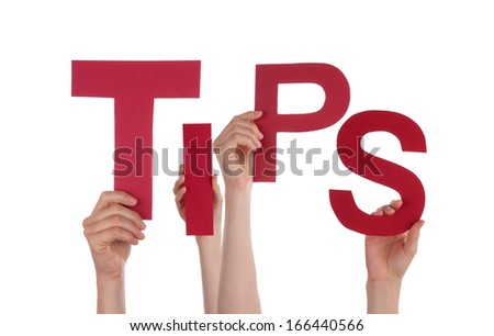Many Hands Holding the Red Word Tips, Isolated - stock photo