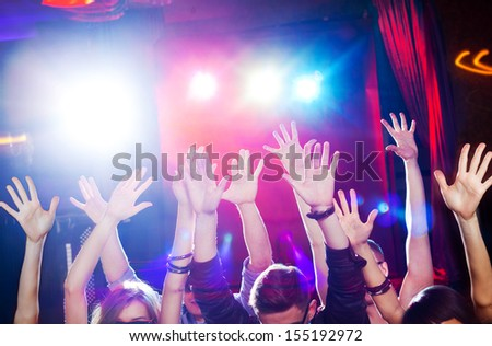 Many hands of the crowd at a youth disco - stock photo