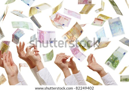 Many hands reaching for flying Euro paper money