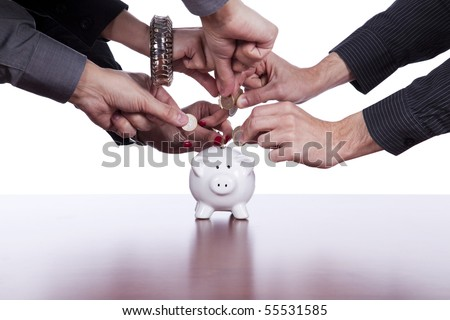 Many hands saving money in the piggy bank - stock photo
