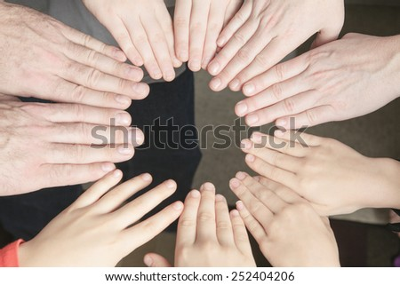 Many hands together inside family house