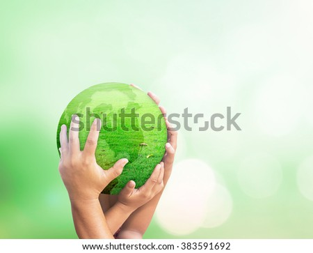 Many Human hand holding globe grass on beautiful nature background. Investment Synergies Ecology CSR Mission Ecosystem Go Green Trust Map Idea Family Justice Medical Support Mother Planet concept. - stock photo