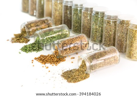 many jars with spices isolated over white - stock photo