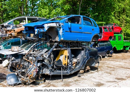 many junk cars in a junkyard waiting for their transport in dei crusher. - stock photo