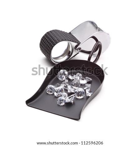 Many kinds of jewelers tools - Shovel Bead scoop with loop Handle, magnifier, tweezers and Diamonds - stock photo