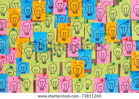 Many light bulb drawn on colorful sticky notes. - stock photo