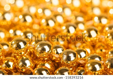 Many little golden balls as beautiful background