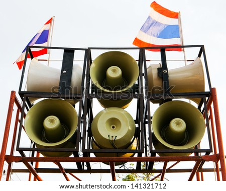 Many loudspeakers against cloudy blue sky - stock photo