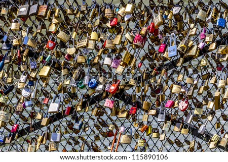 Many Love locks on the bridge in Paris - a symbol of eternal love, friendship and romance. France. - stock photo