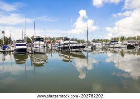 Many luxury yachts parked in boat lagoon, Phuket , Thailand  - stock photo