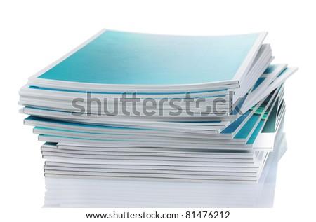 many magazines isolated on white - stock photo