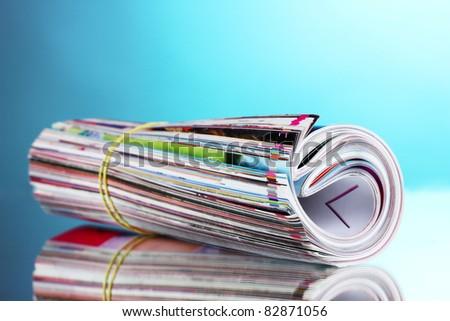 many magazines on blue background - stock photo