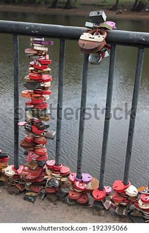 Many marriage love symbol padlocks chained on bridge. lot of marriage love locks  - stock photo