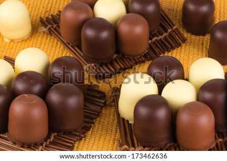 many marshmallows in chocolate on wooden napkins - stock photo