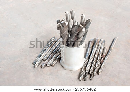 Many metal drill bits. Drilling and milling industry. Closeup. - stock photo