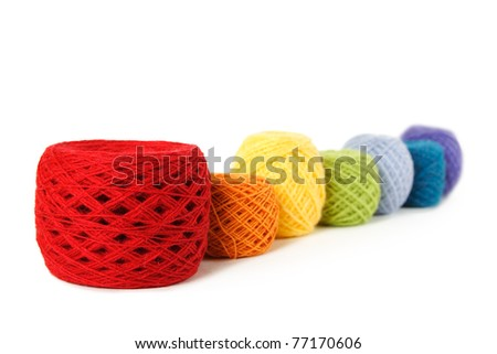 many multicolored clews in a row, isolated - stock photo