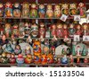Many nested dolls cost beside - stock photo
