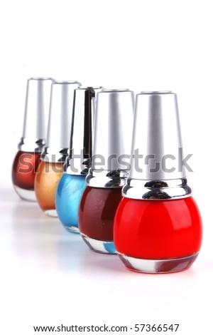 many new nails polish on white background - stock photo