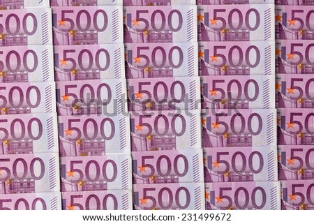 many of five hundred euro banknotes lie side by side. photo icon for wealth and investment - stock photo