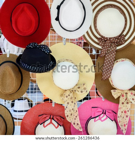 Many of hats for lady hang on wall. - stock photo