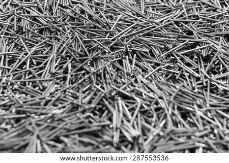 many of metal nails 1 inch small head soft focus on top and bottom - stock photo