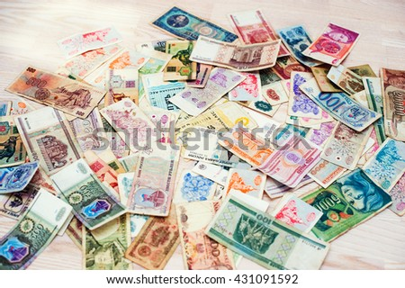 Many old money of different countries on wooden background