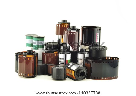 many old photo film rolls over white background