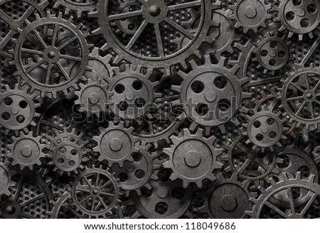 many old rusty metal gears or machine parts