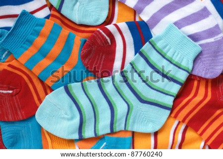 Many pairs of child's striped socks, for backgrounds or textures