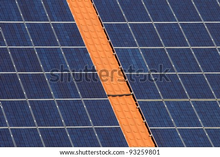 Many panels with solar cells on a roof