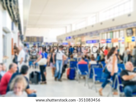 Many passengers at the airport. Blurred image. Suitable for background. - stock photo