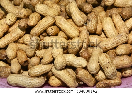 Many peanuts in shells, one upon the other