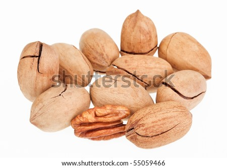 Many pecan nuts isolated on white, one cracked - stock photo