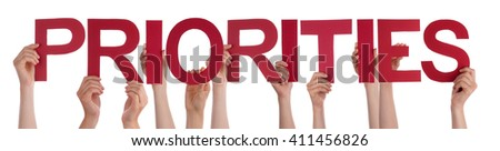 Many People Hands Holding Red Straight Word Priorities - stock photo
