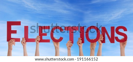 Many People Holding the Red Word Elections in the Sky - stock photo