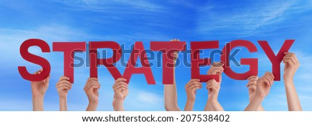 Many People Holding the Word Strategy in the Sky - stock photo