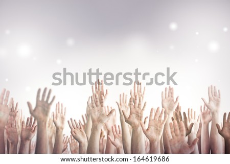 Many people's hands up. - stock photo