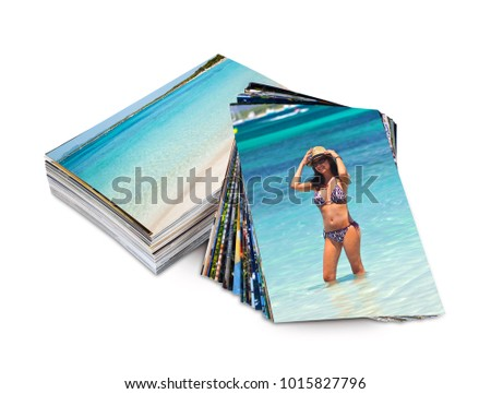 Many photos printed on photo paper with example of a tourist on vacation.