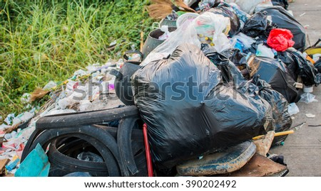 Many pile of domestic garbage in landfill. - stock photo