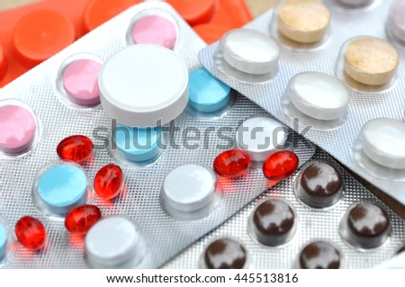 Many Pills and Drugs on table as background